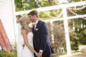 Bride and groom kissing at The Wheeler House Wedding Venue