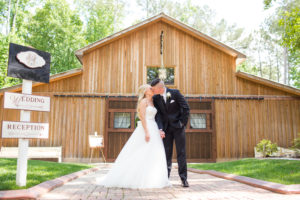 Bride and Groom kissing at The Wheeler House Barn