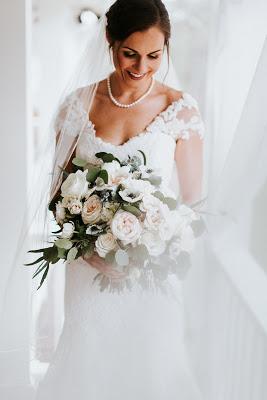 Bride on porch at The Wheeler House